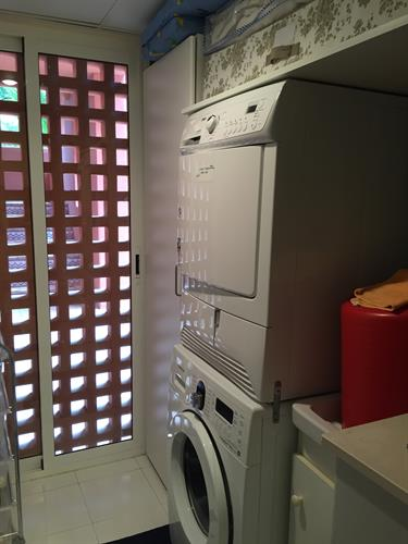washroom with a dryer