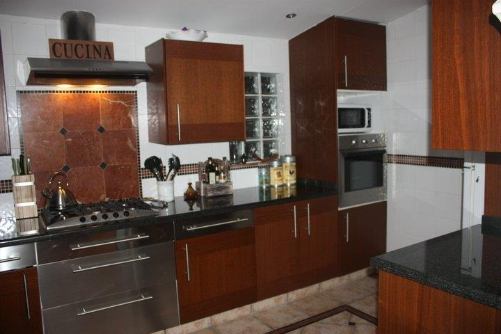 Large fully equipped kitchen with dishwasher, microwave, oven