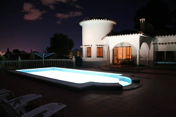 Night time with light in the pool