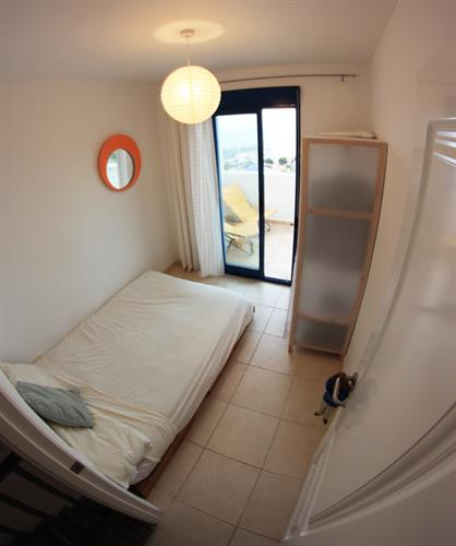 Double room with futon, storage, and a large balcony.
