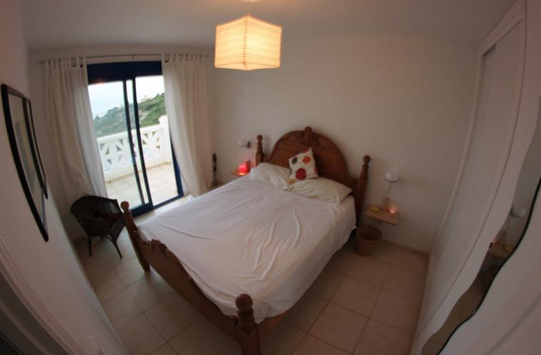 Master bedroom with large cupboard and access to front balcony.