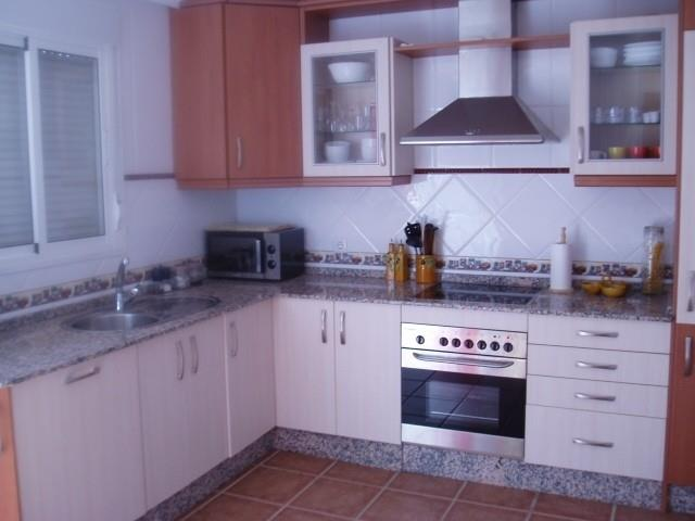 Full fitted kitchen with all modern appliances , table and chairs.