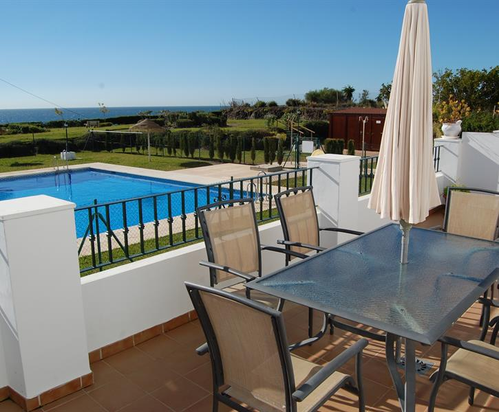 Large terrace overlooking swimming pool , gardens & out to sea