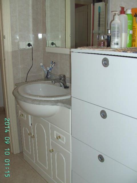 bathroom with toilet, washing machine, bathtob with shower