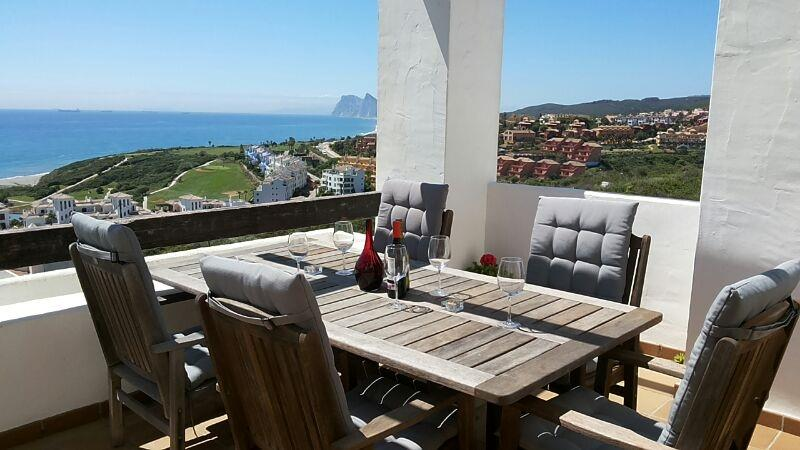 Outdoor dining with views of Gib & Morroco