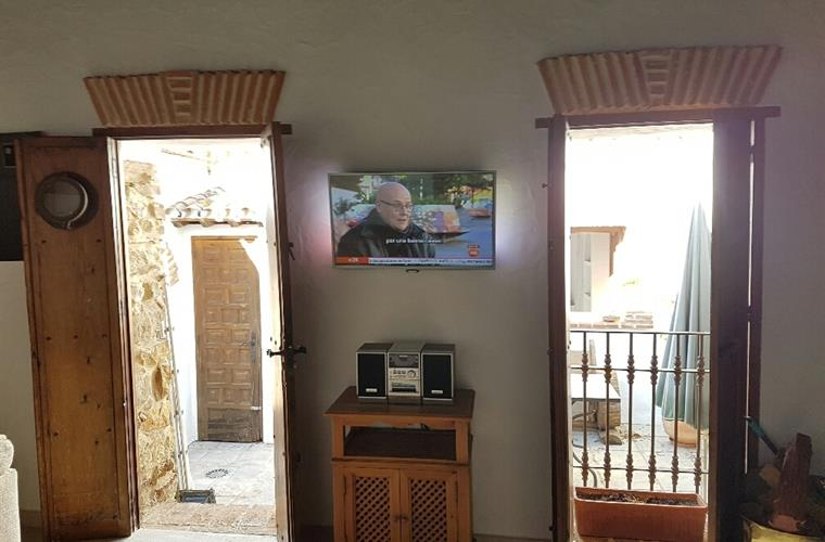 Wall mounted Smart TV with Netflix. Doors to patio