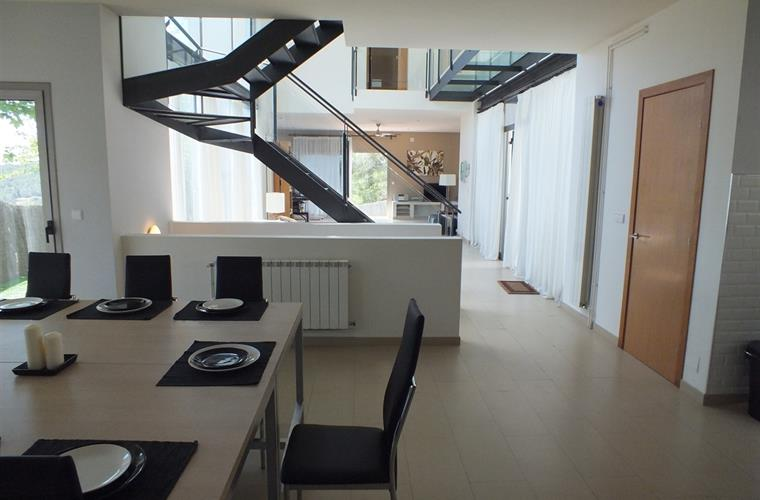Dining area and stairs to the top floor