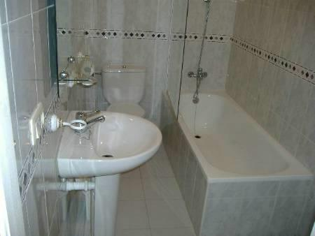 Bathroom with 2 showers