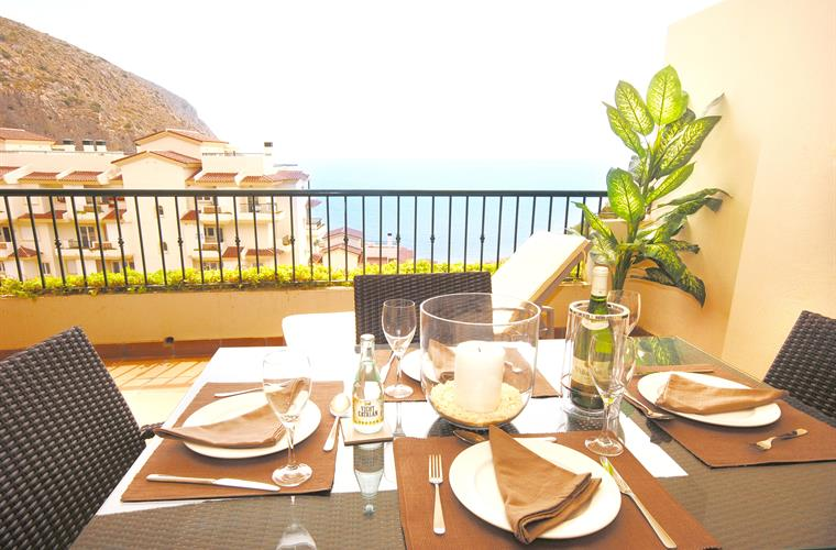 Dining on the terrace and overlooking the sea