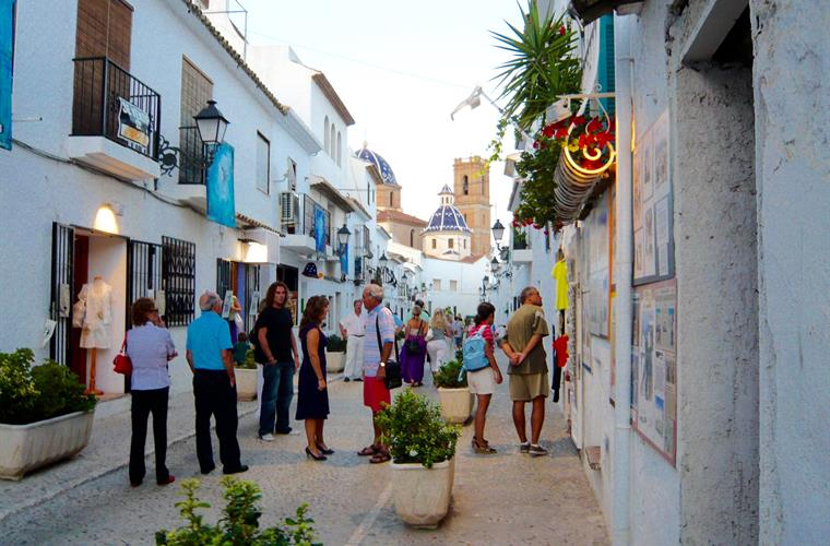 Shopping and dining in the old town of Altea in evening