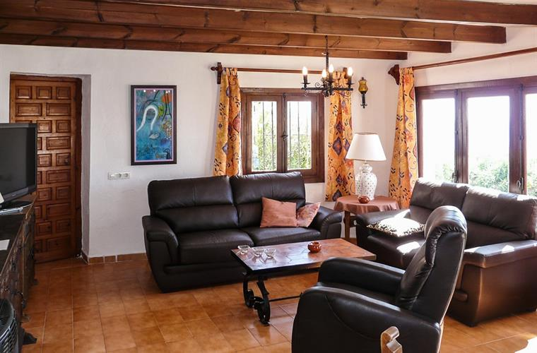 The livingroom offers a more rustic style