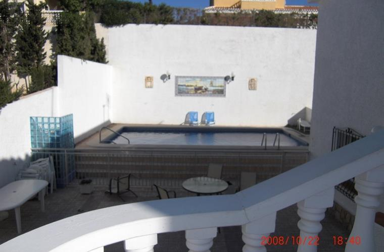 View of pool from staircase