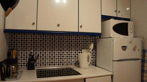 Kitchen with Ceramic hob and cooker below.