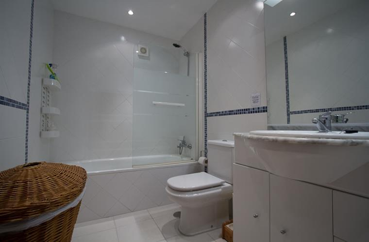 En suite, with bath, shower, close coupled wc