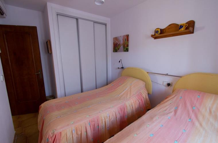 the second bedroom, single beds, excellent cupboards and wardrobe