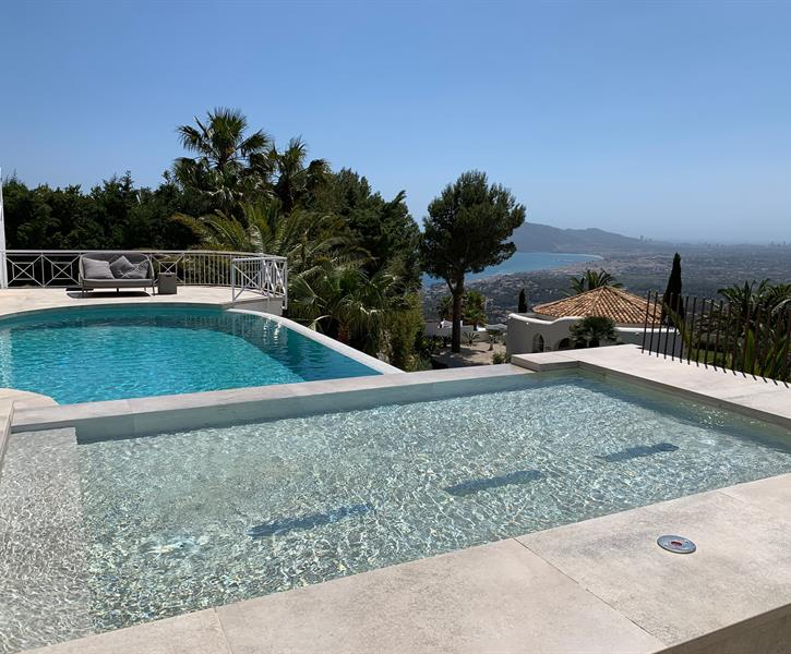 Private heated infinity pool and heated jacuzzi with jet beds