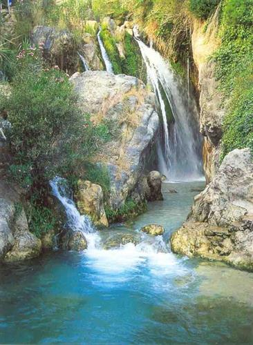 The natural beauty of Fonts del Aqua waterfalls, within easy reach