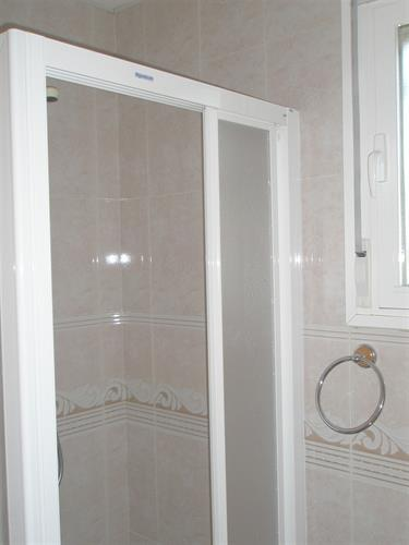 Shower in a cabine.