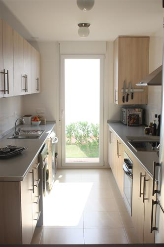 Well equipped kitchen with separate enterance