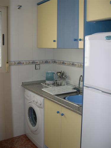 The kitchen with washing machine, fridge-freezer, hob, oven etc.