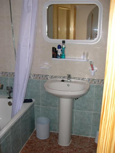 The bathroom with bath/shower, toilet & bidet.