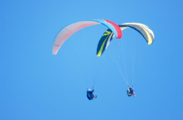 View from terrace of Para Gliders over Morro De Toix take off