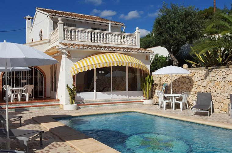 Dining and pool terraces with loungers and parasols