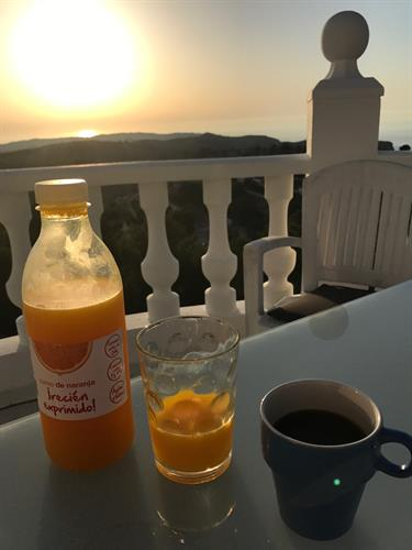 Freshly squeezed orange juice, coffee, and sunset at the veranda.