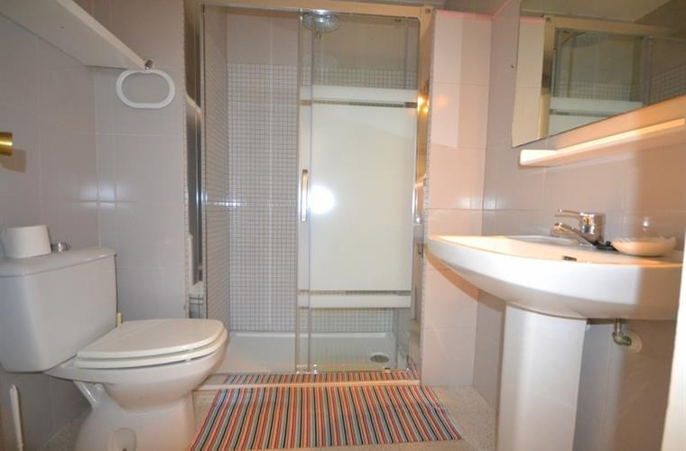 Bathroom with shower and toilet, and plenty enough space.