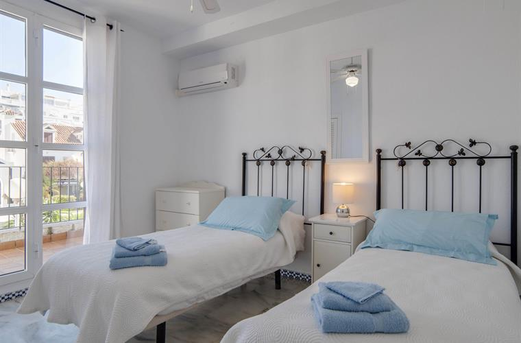 Bedroom 2. Twin beds. rivate balcony overlooking pool.