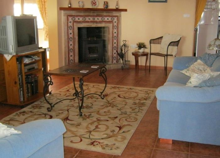 Homely and comfortable living room with log burner stove
