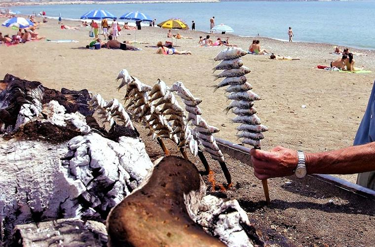 Skewer of sardines on the beach