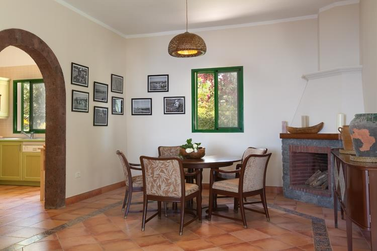 Dining area with pictures about the history of the villas