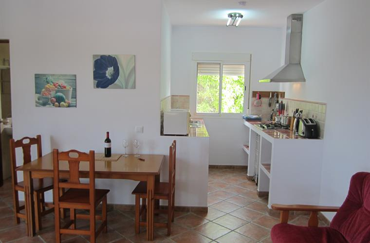 The dining area and fully equipped, very clean galley kitchen.