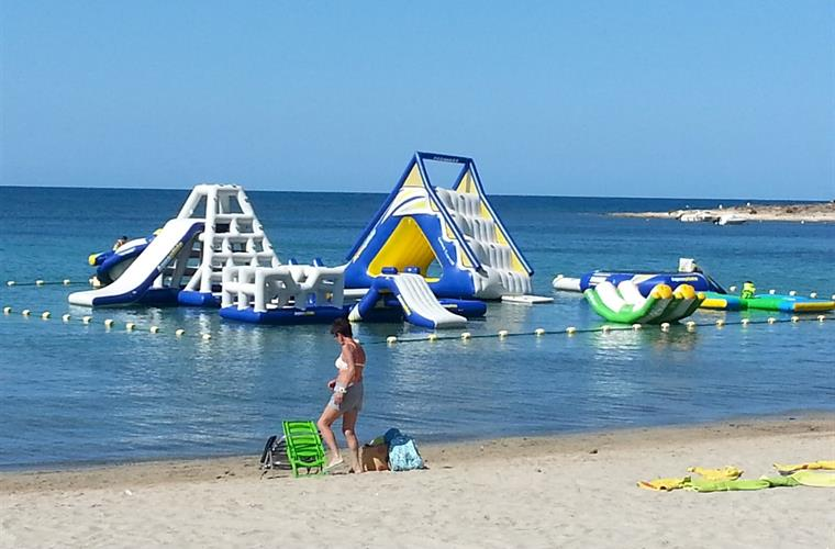 Inflatables on a nearby beach