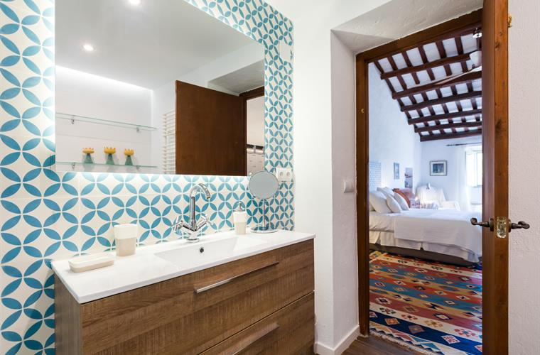 Pedrera bathroom with locally sourced vintage tiles