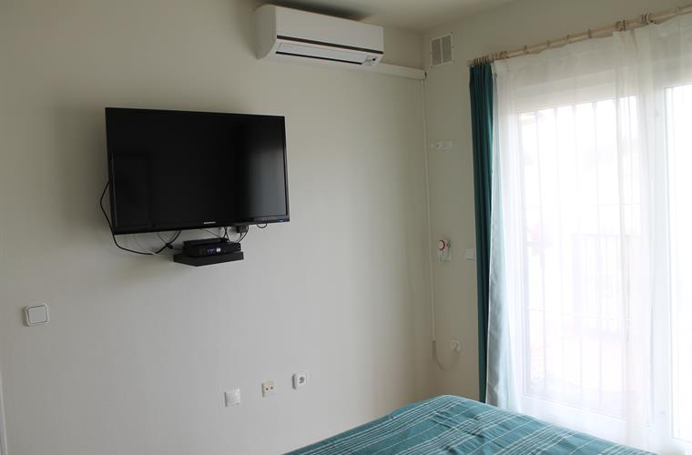 Bedroom 1 with flatscreen tv