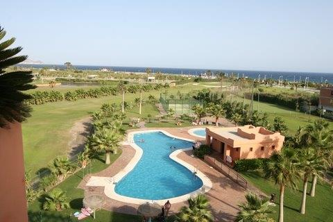 view from terrace over golf course, swimming pool and then the sea