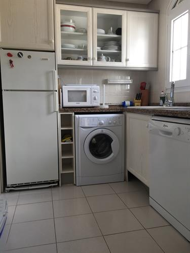 Kitchen with fridge freezer washing machine,dish washer,oven,hob