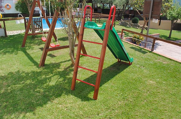 Swings and a slide for children