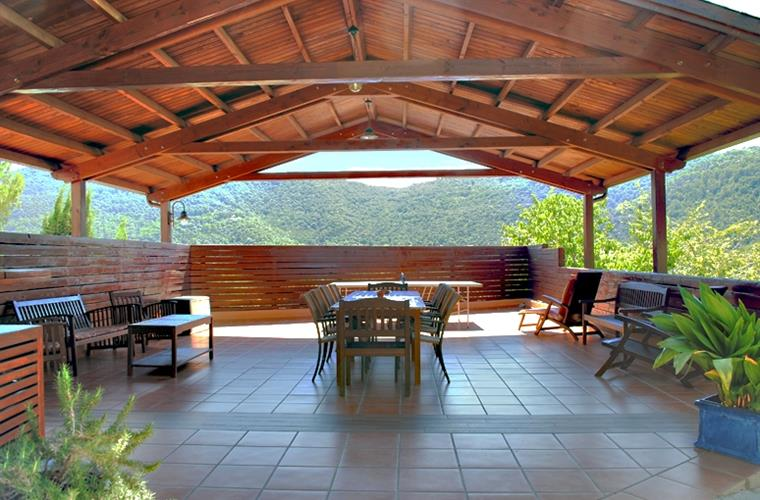 Large wooden-covered porch ideal to do meals outside.