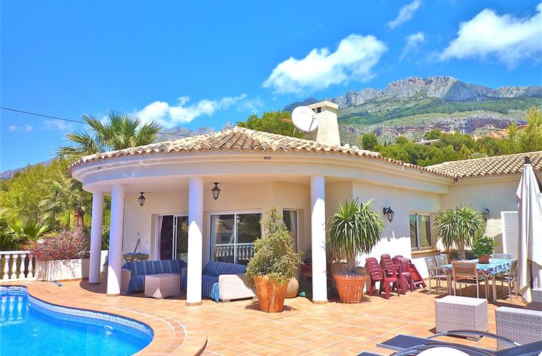 Sun terrace with sun beds, lounge and great mountain and sea views