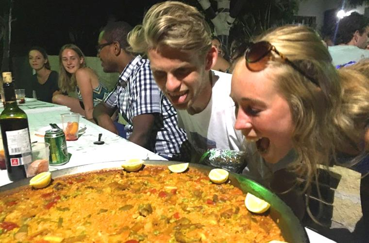 Group of graduates enjoying a paella on their vacation in the gard