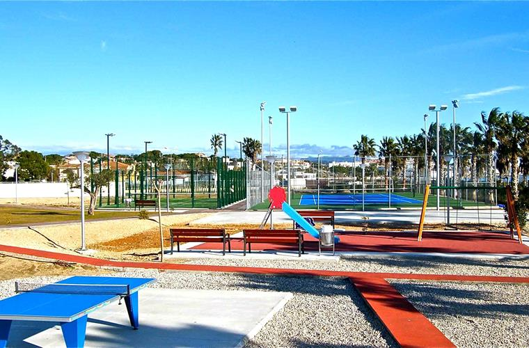 Playground with open air ping pong and tennis and paddle courts