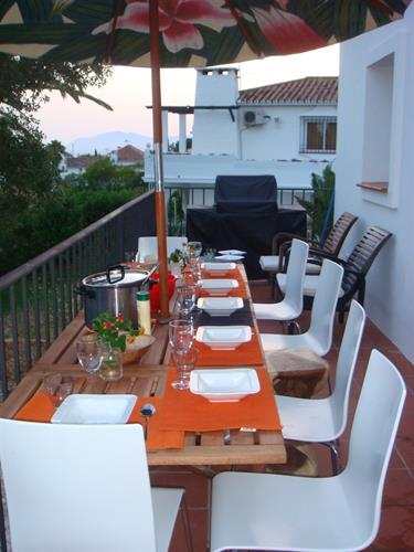 diningtable on the terrace in front of the house