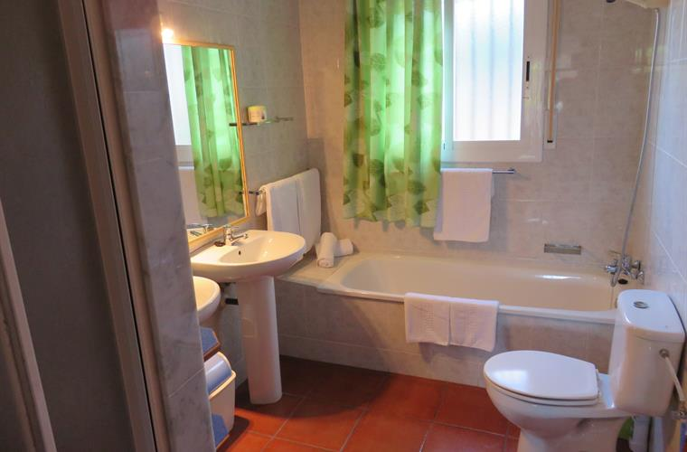 Shared on suite bathroom with shower, bath